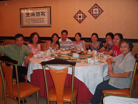 family gathers for food in Guangzhou