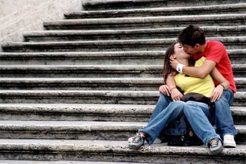 Westerners kissing on steps
