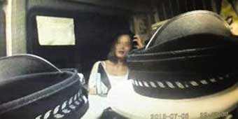 "Chongqing Woman Stopped for Drunk Driving Exposes Shoulders and ""Teases"" Police"