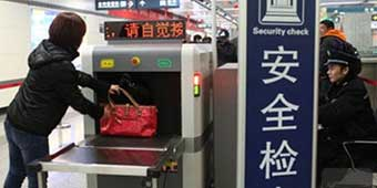 Woman Tries to Bring 2 Guns and 50 Rounds onto Beijing Subway